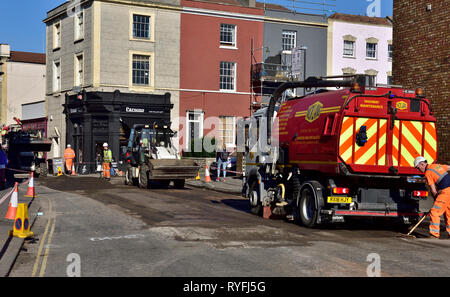 Road resurfacing works with machines used in the process, England, UK - Stock Image