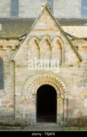 The Norman arch above the north entrance to Brinkburn Priory church, Longframlington, Northumberland, England, UK - Stock Image