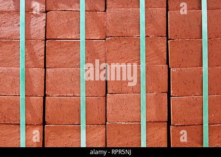 Stack of Red Bricks Bound Together - Stock Image