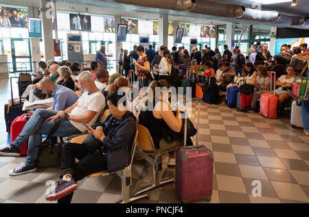 People at the departure gates in the departure lounge, the terminal interior, Pisa International Airport, Pisa, Tuscany, Italy Europe - Stock Image
