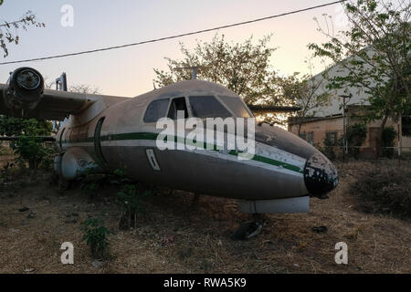 A delerict  Nord 262 aircraft stands on the edge of an airfield in Ouagadougou, Burkina Faso. - Stock Image