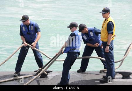 USS Oklahoma City arrives in Guam. - Stock Image