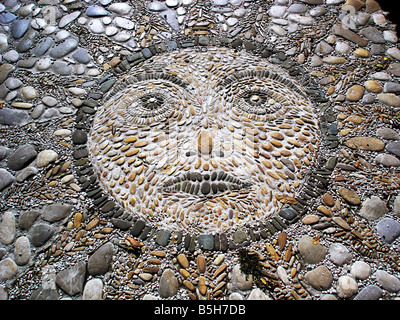 a stone paving pattern in the form of the sun - Stock Image