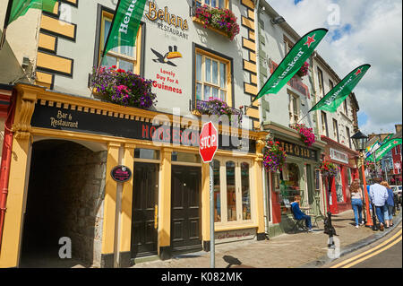 The ornate and colourful building façade of the Horseshoe Inn in the centre of Listowel, County Kerry, Ireland. - Stock Image