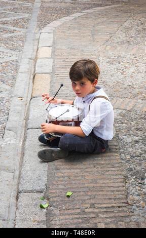 Little drummer boy sitting alone in Seville, Spain - Stock Image