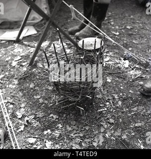 1960s, historical, scout camp, wicker basket ready for burning for the camp fire, England, UK. - Stock Image