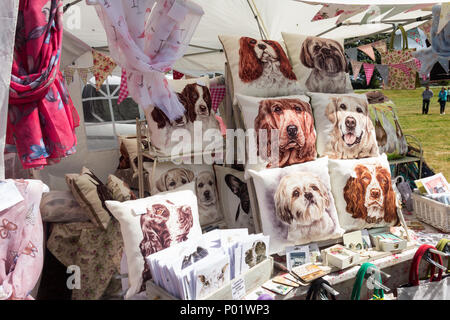 Trade stall selling craft items at the Arthington show, West Yorkshire in 2017, including cushions and greetings cards featuring various dog images. - Stock Image