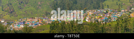 Horizontal panoramic view of the colourful New Colony in Munnar, India. - Stock Image