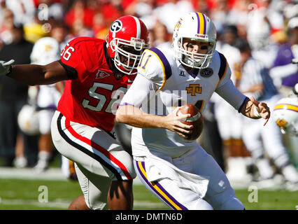Georgia senior defensive tackle Geno Atkins (56) goes after Tennessee Tech quarterback Lee Sweeney (11) in the game against Tennessee Tech at Sanford Stadium at the University of Georgia in Athens, Ga., on Saturday, November 7, 2009. Georgia won the matchup with a 38-0 shutout. (Credit Image: © Daniel Shirey/Southcreek Global/ZUMApress.com) - Stock Image