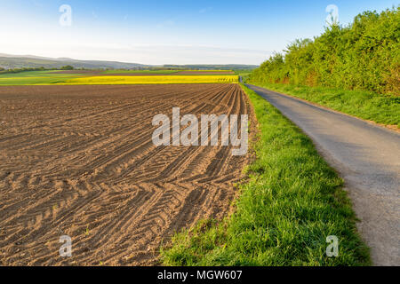 Sunny spring morning in the Taunus mountains, North-West of Frankfurt. View over farmlands near Bad Camberg. - Stock Image