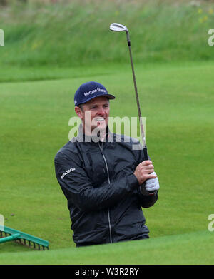 Portrush, County Antrim, Northern Ireland. 17th July 2019. The 148th Open Golf Championship, Royal Portrush Golf Club, Practice day ; Justin Rose (ENG) prepares to play a recovery shot from a bunker at the front of the par three 13th green Credit: Action Plus Sports Images/Alamy Live News - Stock Image