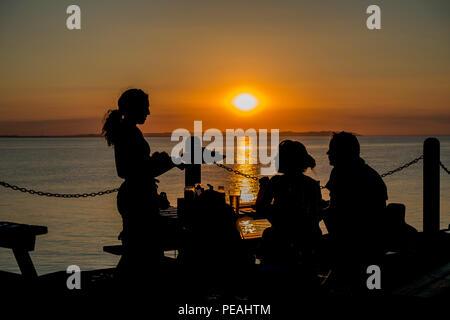 Dinner,Served,Sunset,couple,Whitstable,Kent,Coast - Stock Image
