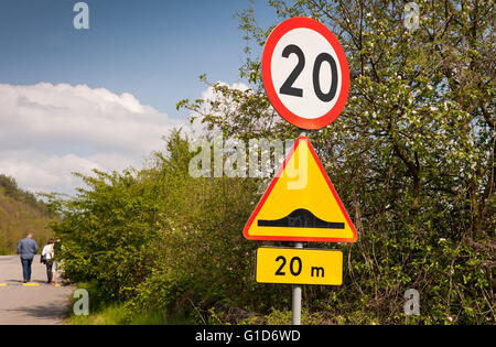 Speed hump and maximum limit of 20, road sign on the wayside in Janowiec village, speed bumps traffic calming for - Stock Image