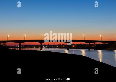 Sunset behind the Bangkok bridge and Bangkok river. - Stock Image
