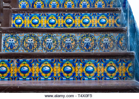 Santa Clara, Villa Clara, Cuba, colonial tiles on a stair. They have blue and yellow as main colors offering a beautiful contrast. - Stock Image