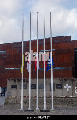 Flags half mast in front of The European Solidarity Centre in Gdansk, Poland after assassination of the Mayor of the city Pawel Adamowicz - Stock Image