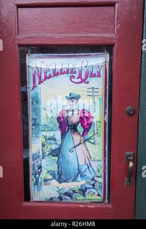 Nellie Bly Poster Drawing Art at Kaleidoscope Store Door, once Jennie Bauters Brothel on Main Street in City of Jerome, Arizona - Stock Image