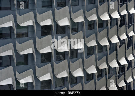 Cladding providing shading in windows of the Centennial Tower, Singapore, Asia - Stock Image