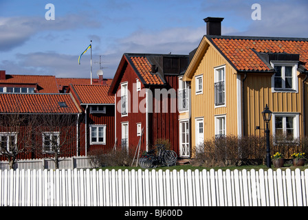 Traditional red and yellow Swedish houses in Mariefred, Sweden. - Stock Image