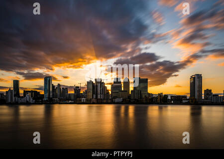 Sunset and dusk over the River Thames and Canary Wharf, London Docklands, London, UK - Stock Image