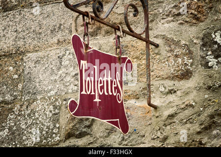 A washroom sign on a stone wall, Saint Malo Ille et Vilaine Brittany France Europe - Stock Image