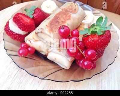 Pancakes with fresh berries - Stock Image