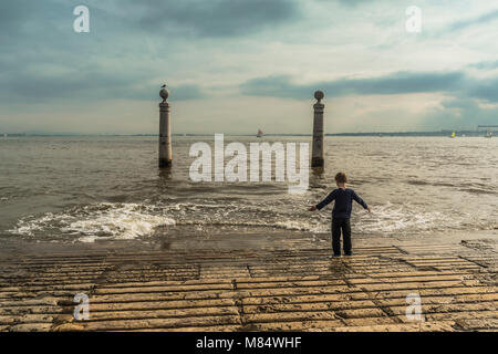 LISBON / PORTUGAL - FEBRUARY 17 2018: SMALL BOY LOOKING AT WATER - Stock Image