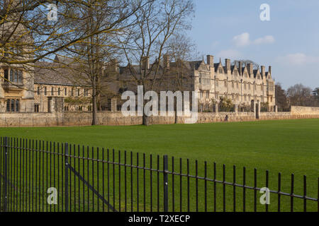 Merton College Oxford early on a sunlit morning, viewed from Christ Church Meadows - Stock Image