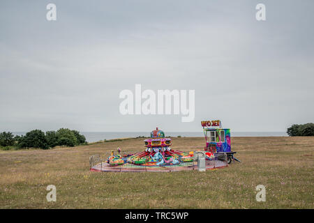 A merry-go-round in a Scandinavian landscape - Stock Image