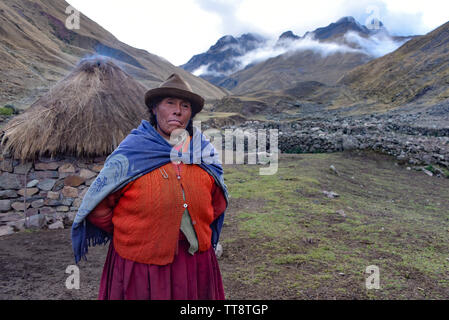 Cusco, Peru - Oct 28, 2018: A proud Andean lady stands in front of her farm building in the remote Quesqe Valley - Stock Image