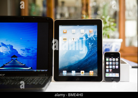16' Laptop, iPhone and Apple iPad compared in size,TouchscreenTablet Computer, Book Reader, Digital Ebook, Modern, - Stock Image