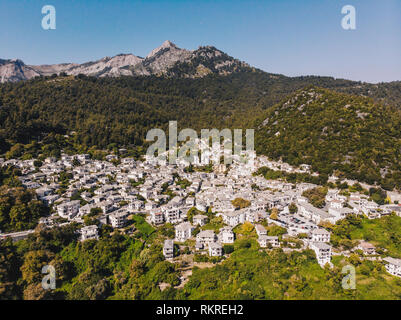 Thasos island small town of Panagia in the middle of the island, with houses painted in white and stone roofs, traditional greek way - Stock Image