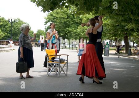 Old Greek woman greets dancers, Spianada, Kerkyra, Corfu, Greece, Europe, - Stock Image