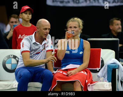 Prague, Czech Republic. 11th Nov, 2018. Czech tennis player Katerina Siniakova (right) and Czech captain Petr Pala are seen during a match against US tennis player Sofia Kenin (not seen) within the 2018 Fed Cup final match between Czech Republic and USA, rubber 3, singles, at the O2 arena in Prague, Czech Republic, on November 11, 2018. Credit: Katerina Sulova/CTK Photo/Alamy Live News - Stock Image