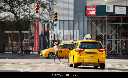 New York, USA - July 01, 2018: Female athlete runs across pedestrian crossing at Columbus Circle on a summer morning. - Stock Image