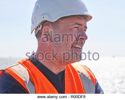 Dock worker with hardhat - Stock Image