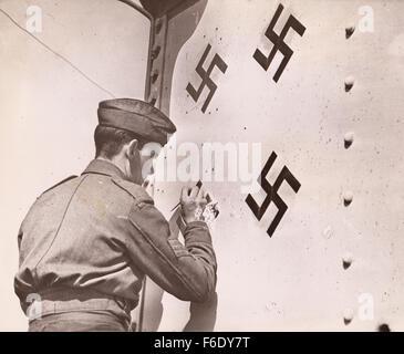 WW2 RAF Flight Sergeant decorates tail of RAF fighter with Luftwaffe Kills - Stock Image