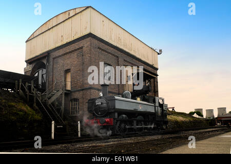 The locomotive coaler at Didcot railway centre re-enacting what  was a daily occurrence on Britain's railways - Stock Image