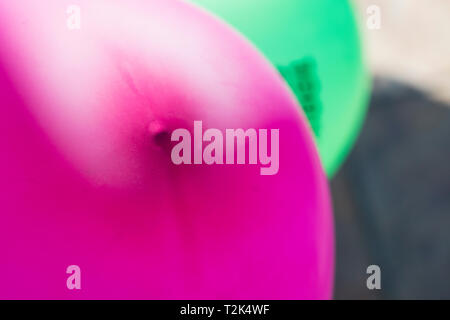texture of blurred pink balloon on a sunny day. - Stock Image