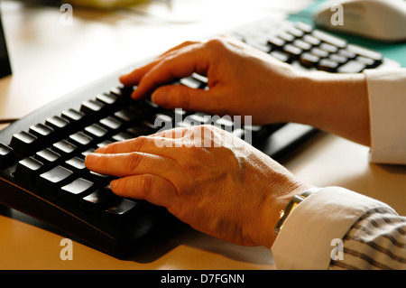 PC keyboard, hands on keyboard, tapping - Stock Image