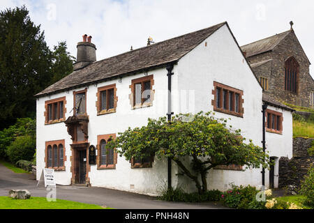 Exterior of the 16th century grammar school in the village of Hawkshead, Cumbria. The grammar school was founded in 1585. The building dates from 1675 - Stock Image