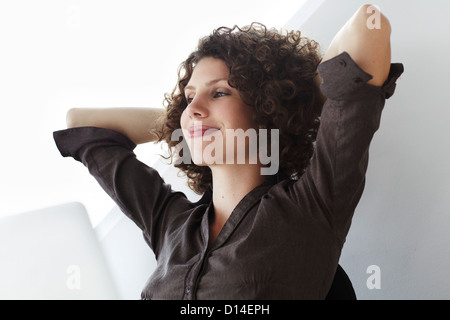 portrait of content young businesswoman - Stock Image