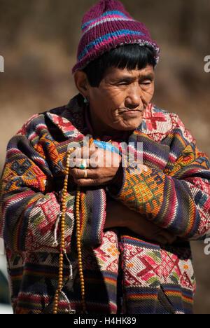 Elderly female nomadic yak-herder at Pele La, a 3420-m mountain pass between Trongsa and Wangdue Phodrang in Bhutan. - Stock Image