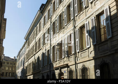 A street of tall stone-fronted buildings in the medieval old town / Cite of Geneva / Geneve, Switzerland. - Stock Image