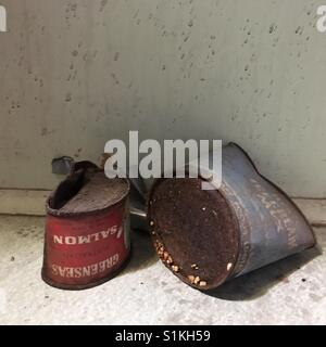 Empty rusted old food tins - Stock Image