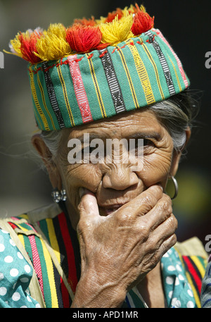 An Igorot woman poses for the camera in Baguio City, Philippines. - Stock Image