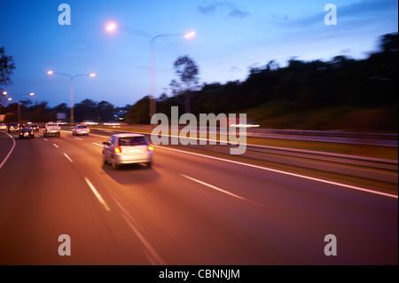 Freeway traffic at dusk - Stock Image