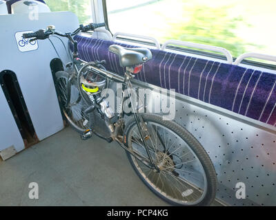 Bicycle travelling by train, bike on train - Stock Image