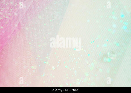 A beautiful and elegant macro of glitter from sparkling diamonds with bokeh or depth of field, space and pink texture as background - Stock Image