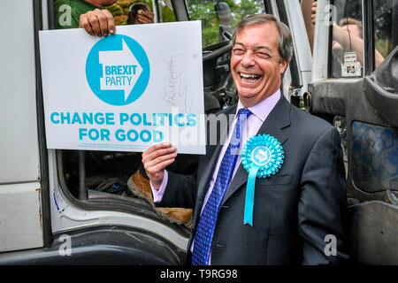 Brexit Party leader Nigel Farage holds a placard during the campaign trail in Exeter, ahead of this week's European elections. - Stock Image